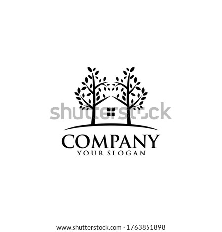 Green Wood Resident Vector logo. Design template of two trees incorporate with a house that made from a simple scratch. it's good for symbolize a property or wooden housing business. ストックフォト ©