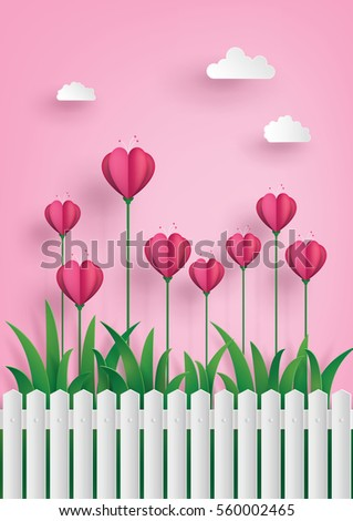 Greeting card of love and Valentine's Day. Heart shape flowers on the grass ,paper art craft style.