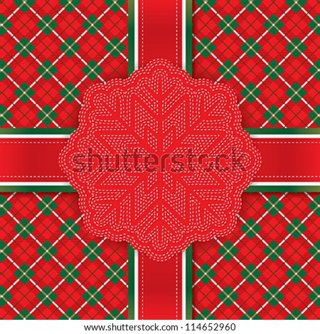 Greeting card with the snowflake on the plaid fabric