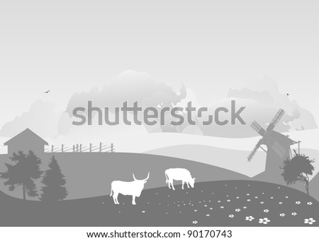 grey country landscape with cows on field