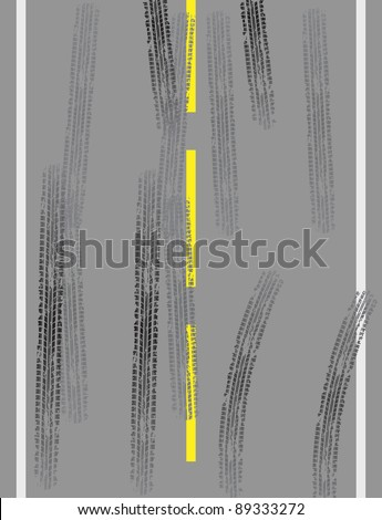 Grey road with tire tracks