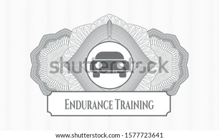 Grey rosette (money style emblem) with car seen from front icon and Endurance Training text inside