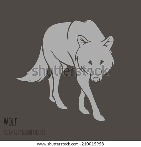 grey wolf silhouette on brown