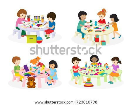 group of children painting on...