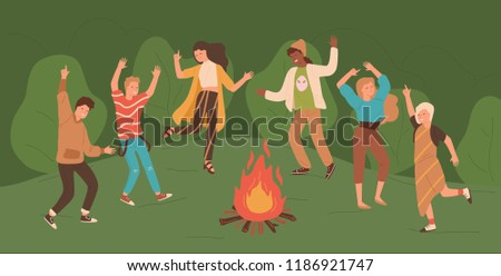 Group of happy young men and women dancing around bonfire in forest. People enjoying party in woods. Male and female cartoon characters jumping beside fire. Colorful vector illustration in flat style.