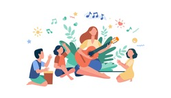 Group of kids clapping hands at their teacher playing guitar. Children enjoying music class outdoors. Can be used for daycare, education, musical school concepts