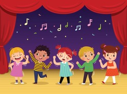 Group of kids dancing and singing a song on the stage. Children's performance.