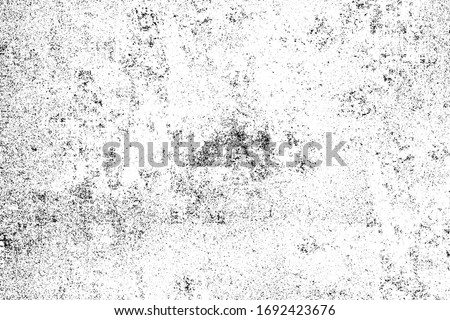 Grunge black and white. Abstract monochrome background. Vector pattern of scratches, chips, scuffs. Vintage worn surface. Old wall texture Foto stock ©