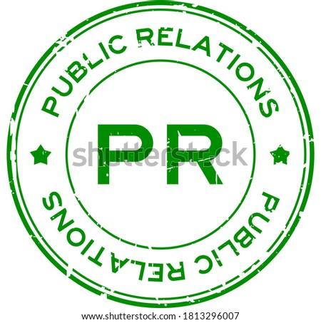Grunge green PR Public Relations word round rubber seal stamp on white background