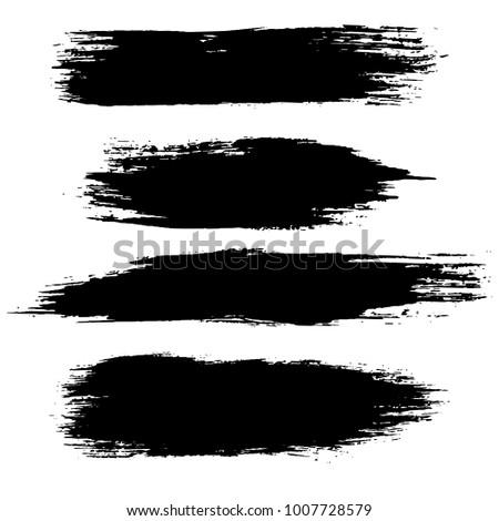 Grunge ink brush strokes set. Freehand black brushes. Handdrawn dry brush black smears. Modern vector illustration.