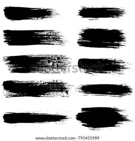 Grunge ink brush strokes set. Freehand black brushes. Handdrawn dry brush black smears. Modern vector illustration. #795455989
