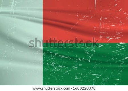 Grunge Madagascar flag. Madagascar flag with waving grunge texture. Vector background.