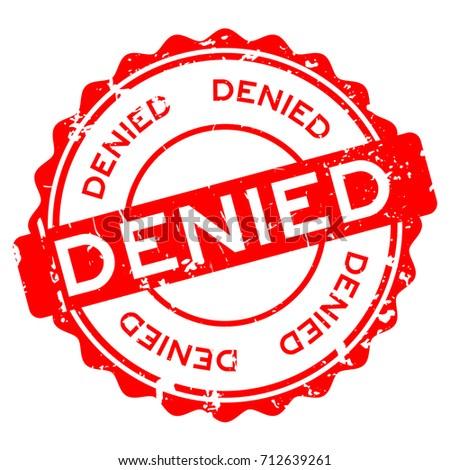 Grunge red denied wording round rubber seal stamp on white background