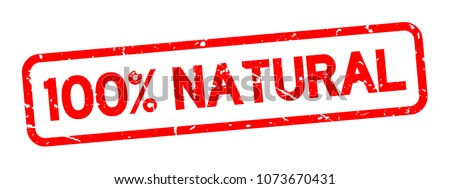 Grunge red 100 percent natural square rubber seal stamp on white background