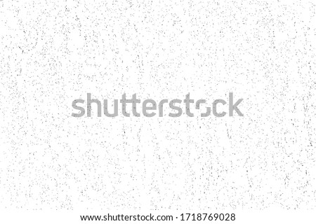 Grunge surface texture with small, randomly scattered dots. Abstract monochrome background with grain, sand and mud. Vector illustration. Overlay template. Foto d'archivio ©