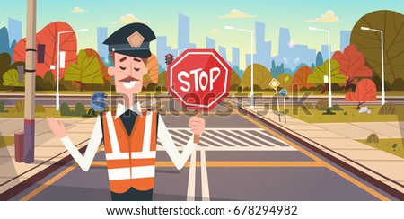 guard with stop sign on road