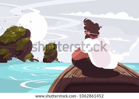 guy sitting on wooden boat in
