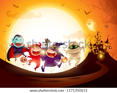 Halloween Kids Costume Party. Group of kids in Halloween costume jumping in the moonlight.