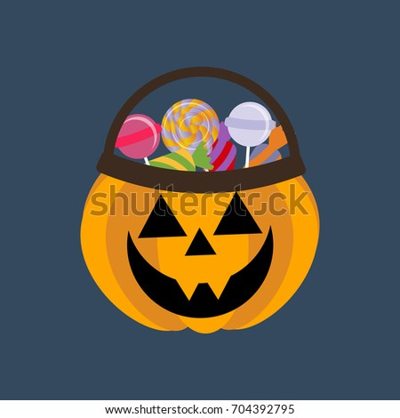 Halloween pumpkin and candies on the blue background. Vector illustration