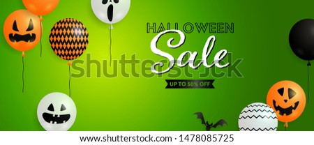Halloween Sale banner with ugly mask air balloons and bats on green background. Up to fifty percent lettering can be used for posters, leaflets, flyers
