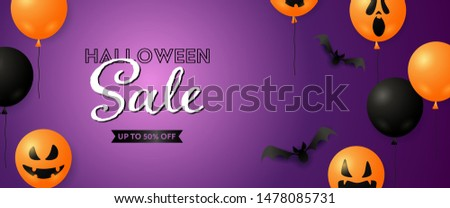 Halloween Sale with ugly mask air balloons and bats on purple background. Up to fifty percent lettering can be used for posters, leaflets, announcements