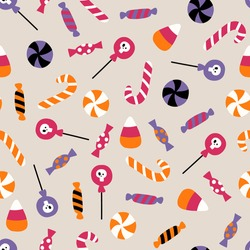 Halloween vector seamless pattern with candy. Pattern with sweets for Halloween. Flat illustration. For textiles, wrapping paper, gift paper, fabric.