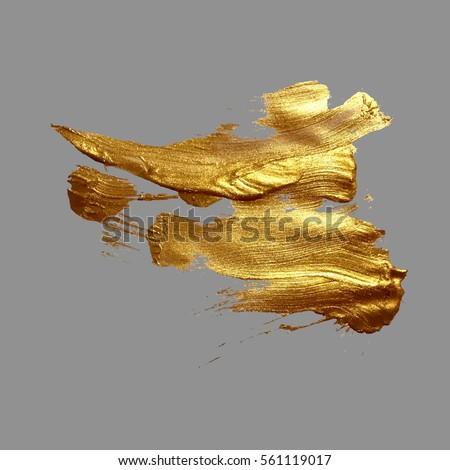 hand drawing gold brush stroke paint spot on a gray background, handmade vector illustration