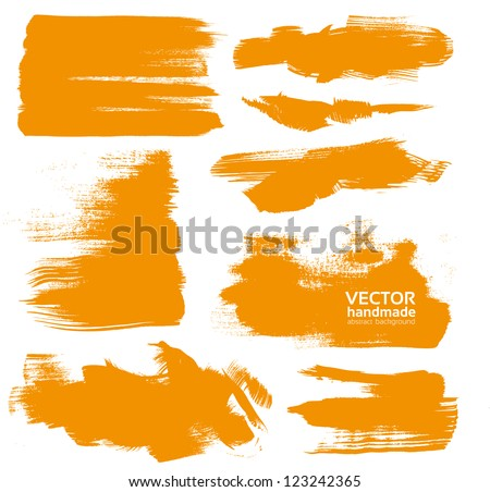 Hand-drawing orange textures of brush strokes in random shape