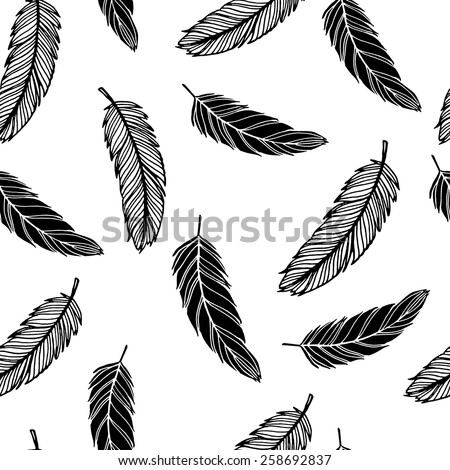 Hand drawn black and white feathers seamless pattern