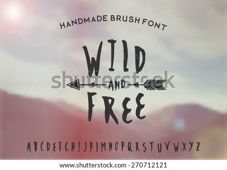 Hand drawn brush font on a blurred vintage style mountain view background. EPS 10 file, gradient mesh and transparency effects used.