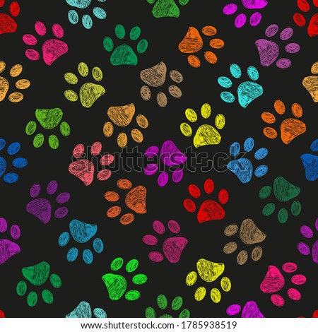 Hand drawn colorful paw prints. Foot prints black background Photo stock ©