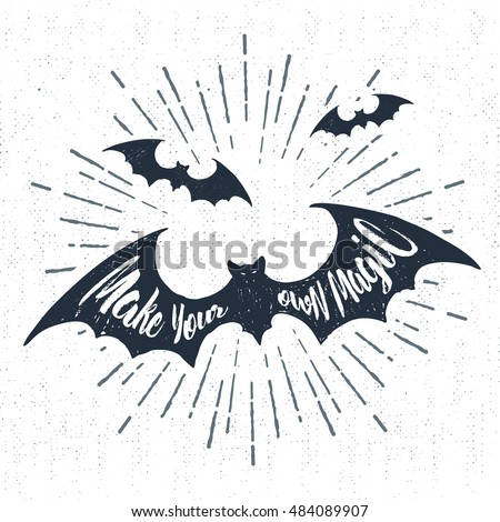 "Hand drawn Halloween label with textured bats vector illustration and ""Make your own magic"" inspirational lettering."