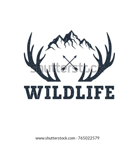 Hand drawn inspirational label with mountains and antlers textured vector illustrations and