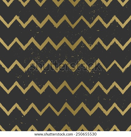 Hand drawn style chevron seamless pattern. Stylish and elegant zig zag repeat pattern in black and golden.