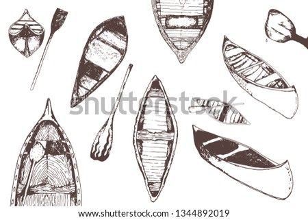 hand drawn traced collection of monochrome canoes isolated on white.