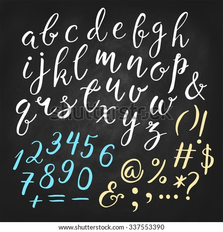Hand drawn vector calligraphic English alphabet with numbers, ampersand and symbols written with brush pen. Chalkboard background