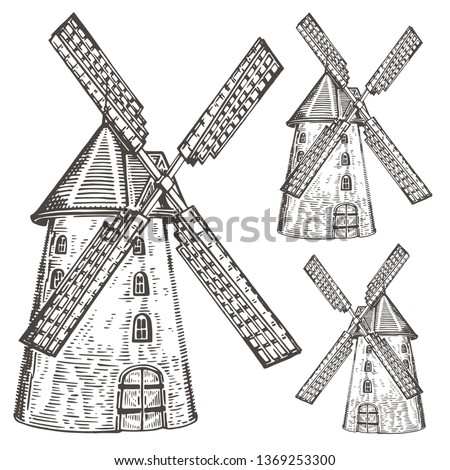 Hand drawn vintage windmill. Engraved style vector illustration isolated on white background