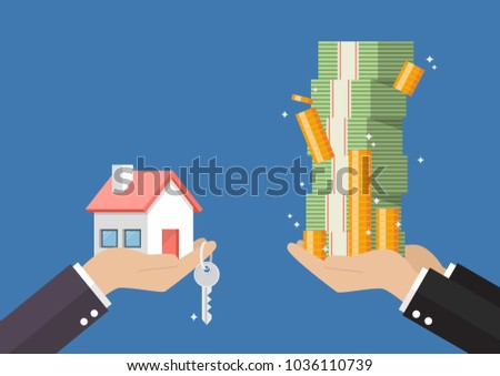Hand gives home and key to other hand with money cash. rental or lease a car
