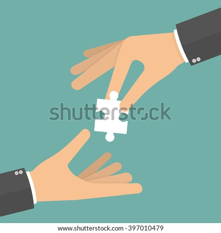 hand giving a puzzle piece to
