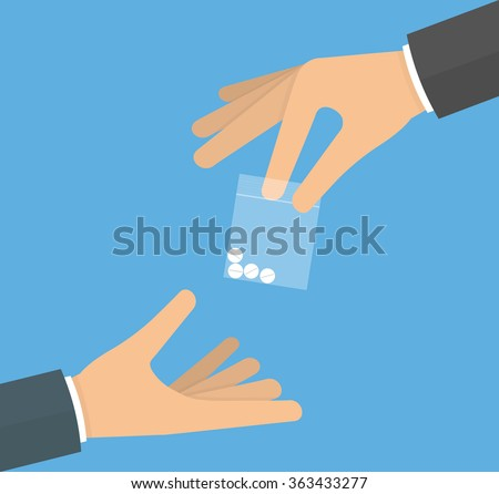 hand giving drug pills in a