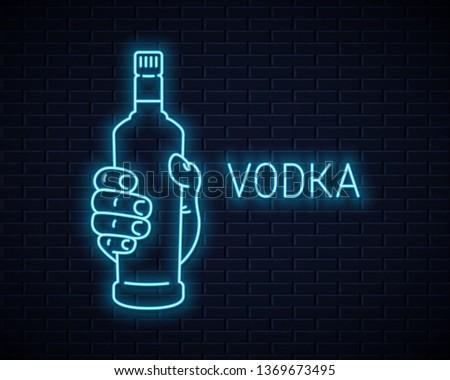 hand hold vodka bottle neon