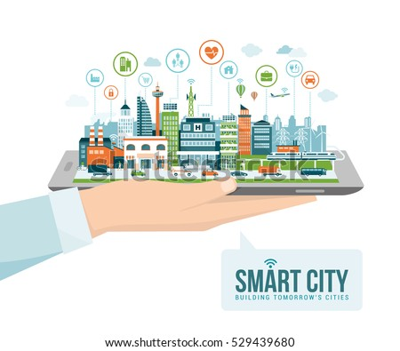 Hand holding a digital tablet with a contemporary smart city and apps icons: augmented reality and internet of things concept