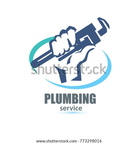 hand holding a wrench  plumbing