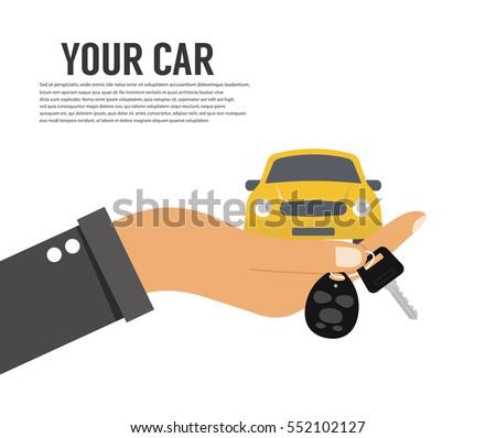 Hand holding car key