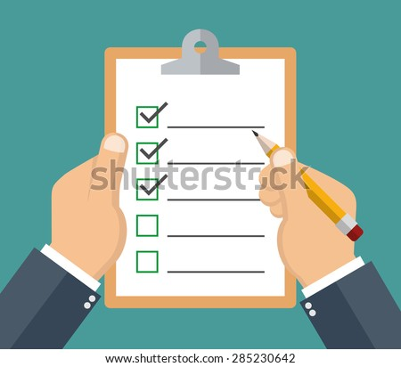 Hand holding clipboard with checklist and pencil