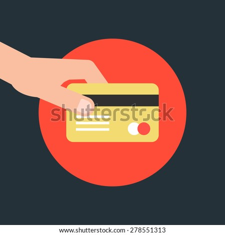 hand holding credit card in red
