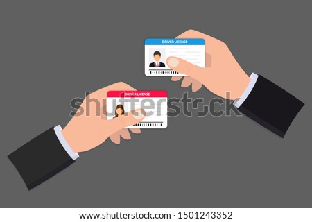 Hand holding Driver license. ID card. Identification card icon. Man and woman driver license card template. Icon driver's license. Man showing a driver license, identity verification, person data.  Stock fotó ©