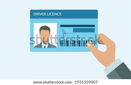 Hand holding Driver license. ID card. Identification card icon. Man and woman driver license card template. Icon driver license. Stockfoto ©