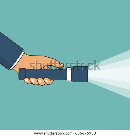 hand holding flashlight search