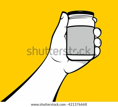 Hand holding food jar